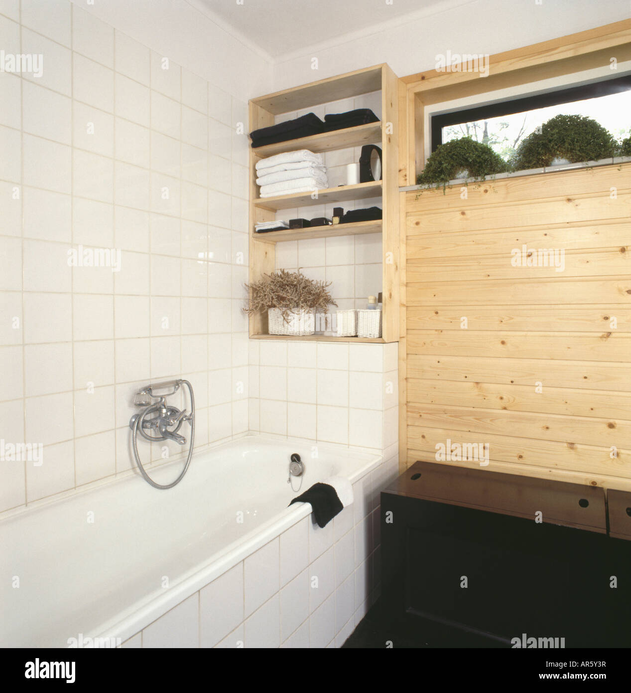 https www alamy com stock photo shelves above bath in seventies bathroom with white tiled wall and 15949402 html