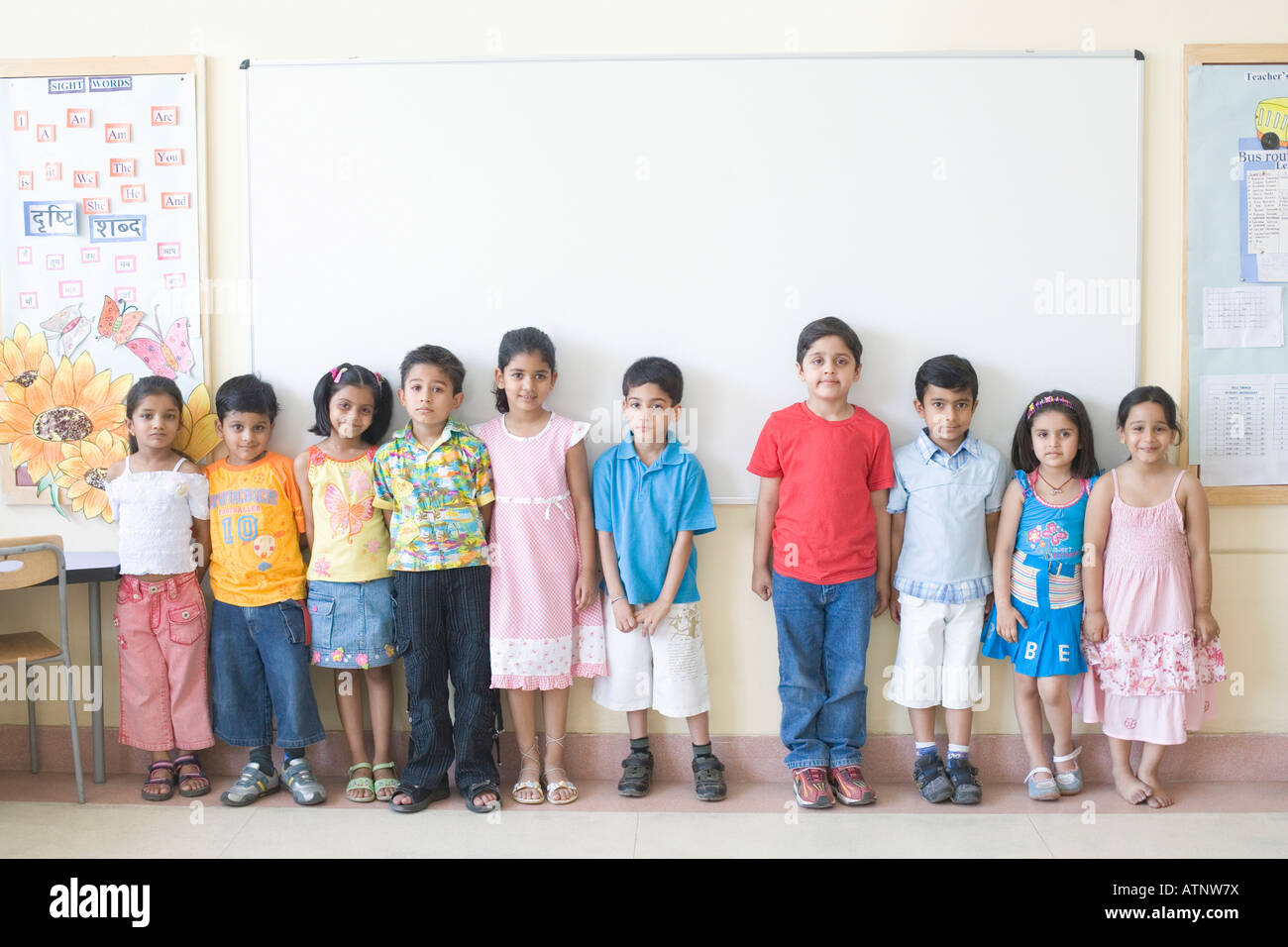 Children Standing In Front Of The Whiteboard In A