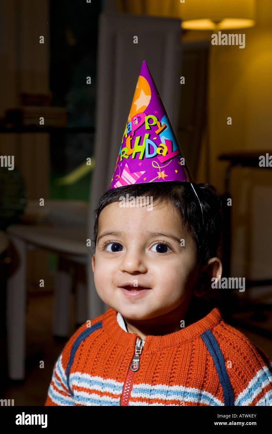 One Year Old Baby Boy Wearing Happy Birthday Cone Hat Stock Photo Alamy