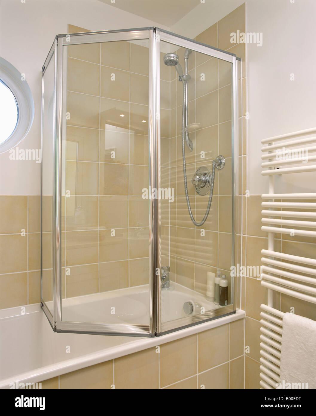 Folding Glass Shower Doors On Bath In Modern Bathroom With