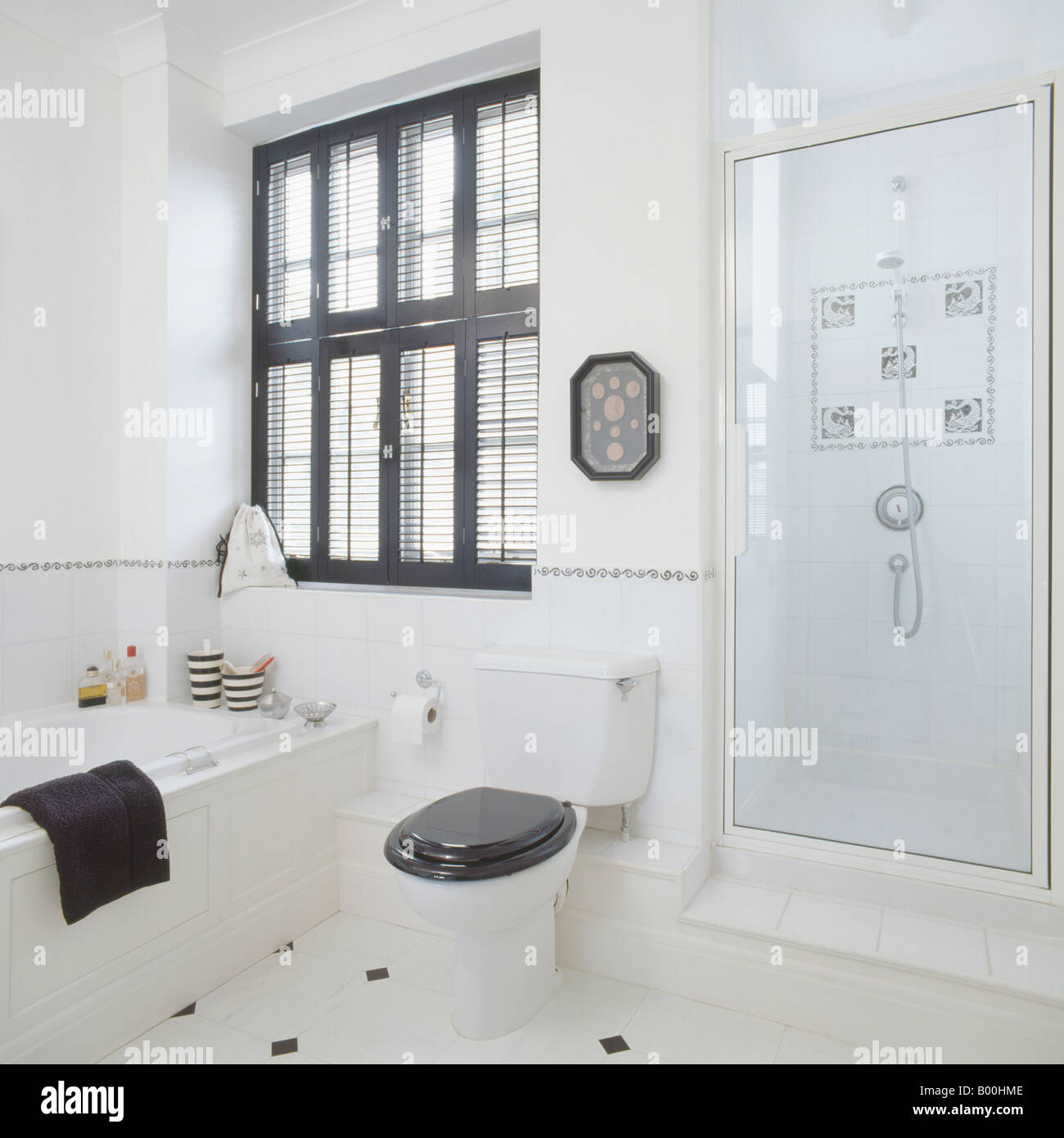 Black Plantation Shutters Above Bath And Black Toilet Seat
