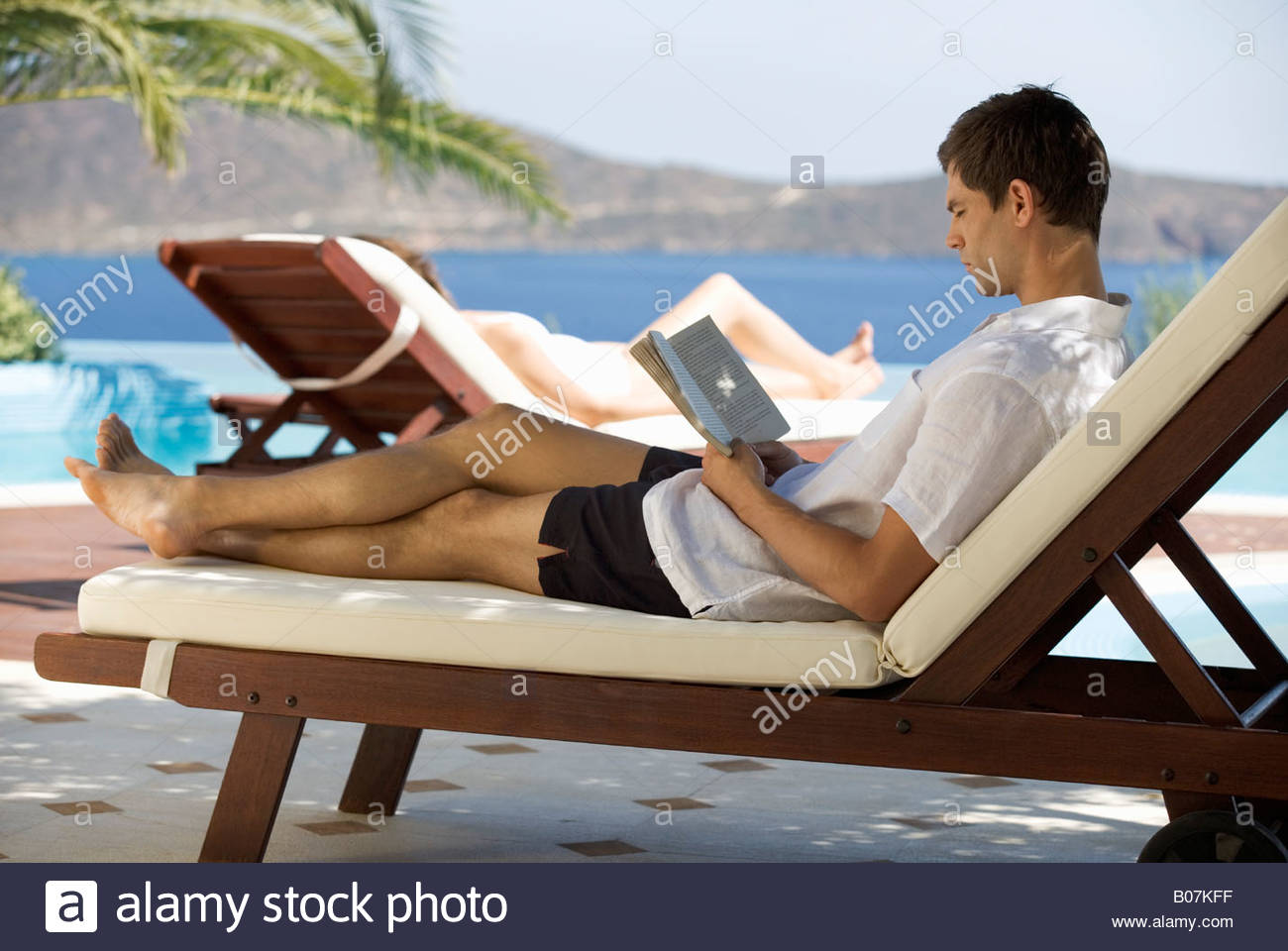Image result for image of man on deck chair reading paperback