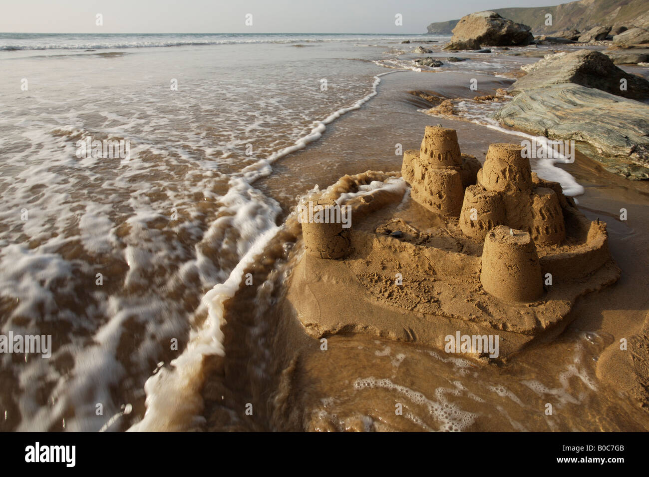 Image result for sand castles being washed away