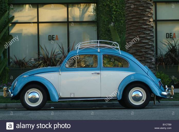 blue vw bug volkswagen beetle parked outside dea office drug stock