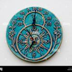 Ceramic Clock And Thermometer Mounted On Outdoor Wall Stock Photo Alamy