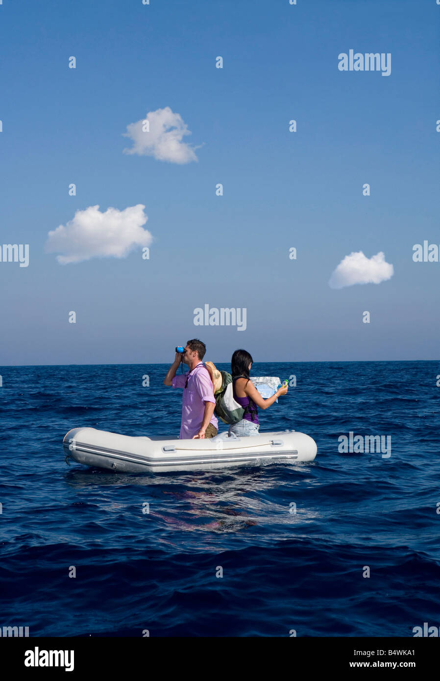 Couple Lost At Sea On Little Boat Stock Photo 20232969