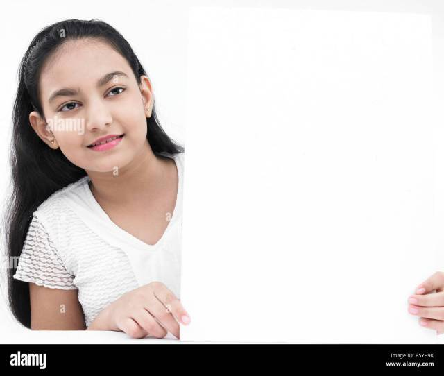 A Pretty Asian Teenage Girl Of Indian Birth With A Blank White Board Stock Image