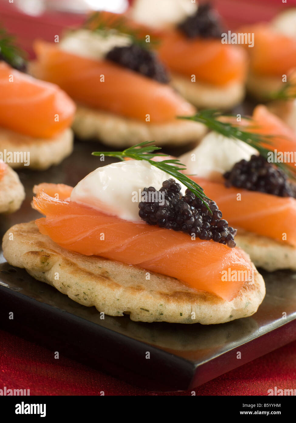 smoked salmon blinis canap s with sour cream and caviar stock image