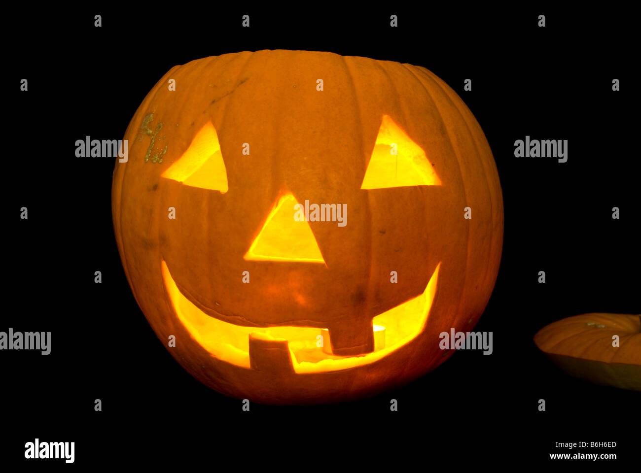 Glowing Candle Lit Halloween Pumpkin Head Carved Jack O