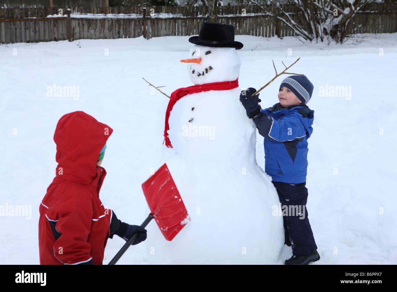 Kids Building Snowman Stock Photos Amp Kids Building Snowman