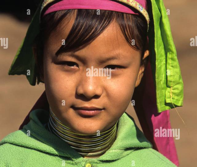 Portrait Of A Young Burmese Padaung Long Necked Girl In Refugee Camp Mae