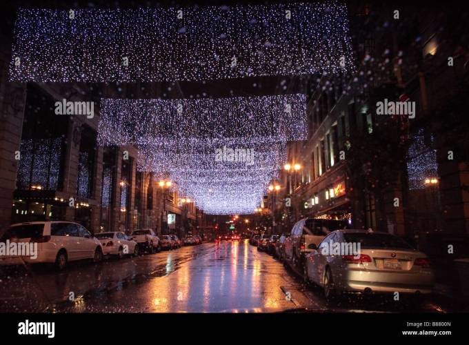 4th street los angeles with christmas light decorations on rainy