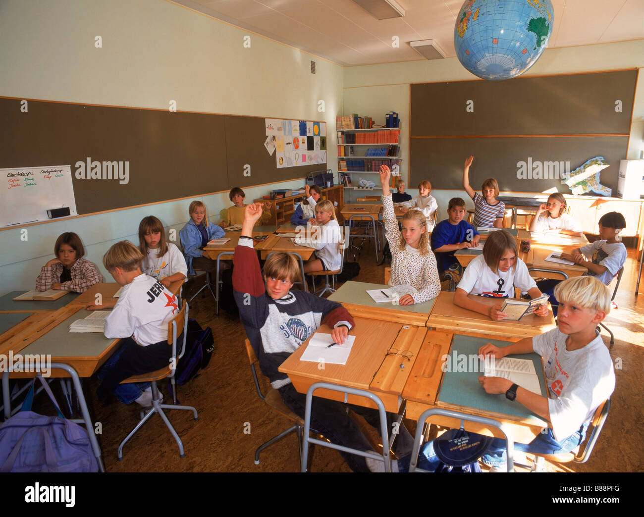 Students In 5th Grade Swedish Classroom Sitting At Desks With Raised Stock Photo Royalty Free