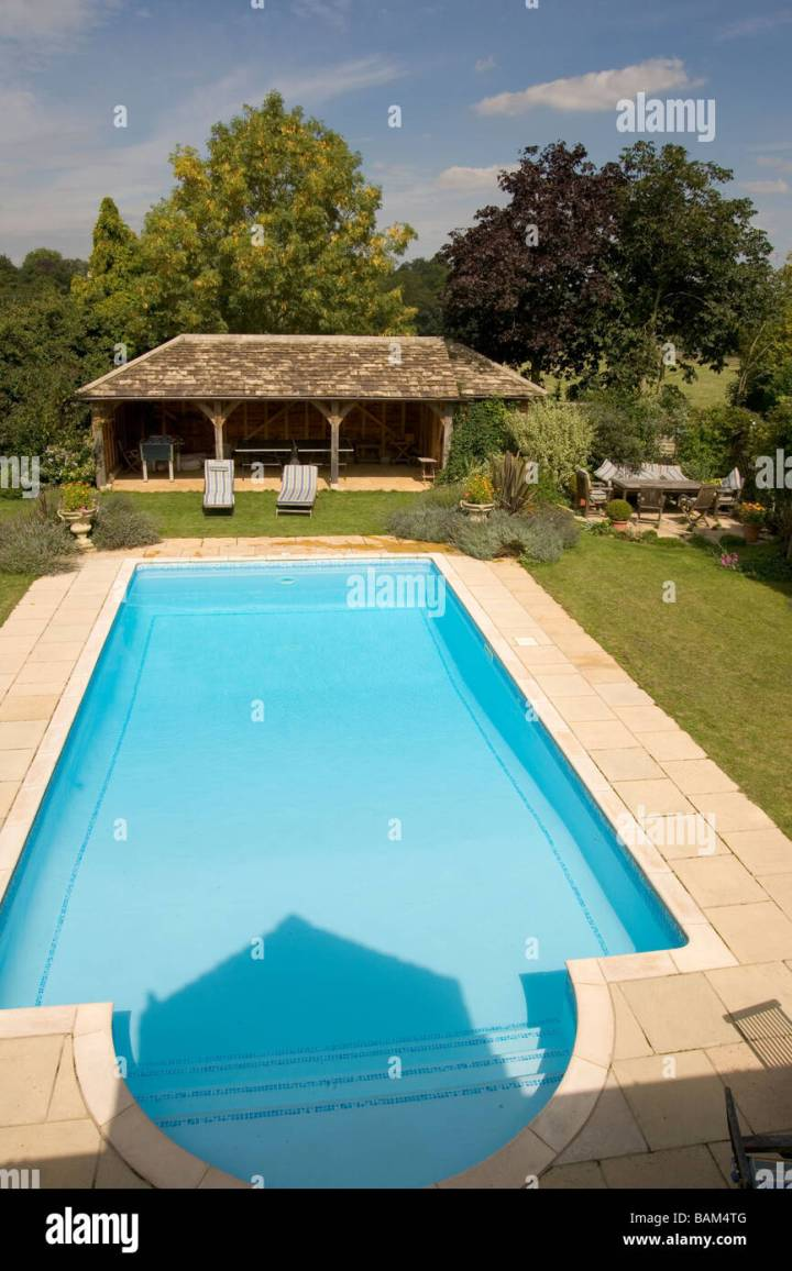 uk. a private garden swimming pool stock photo: 23799792 - alamy