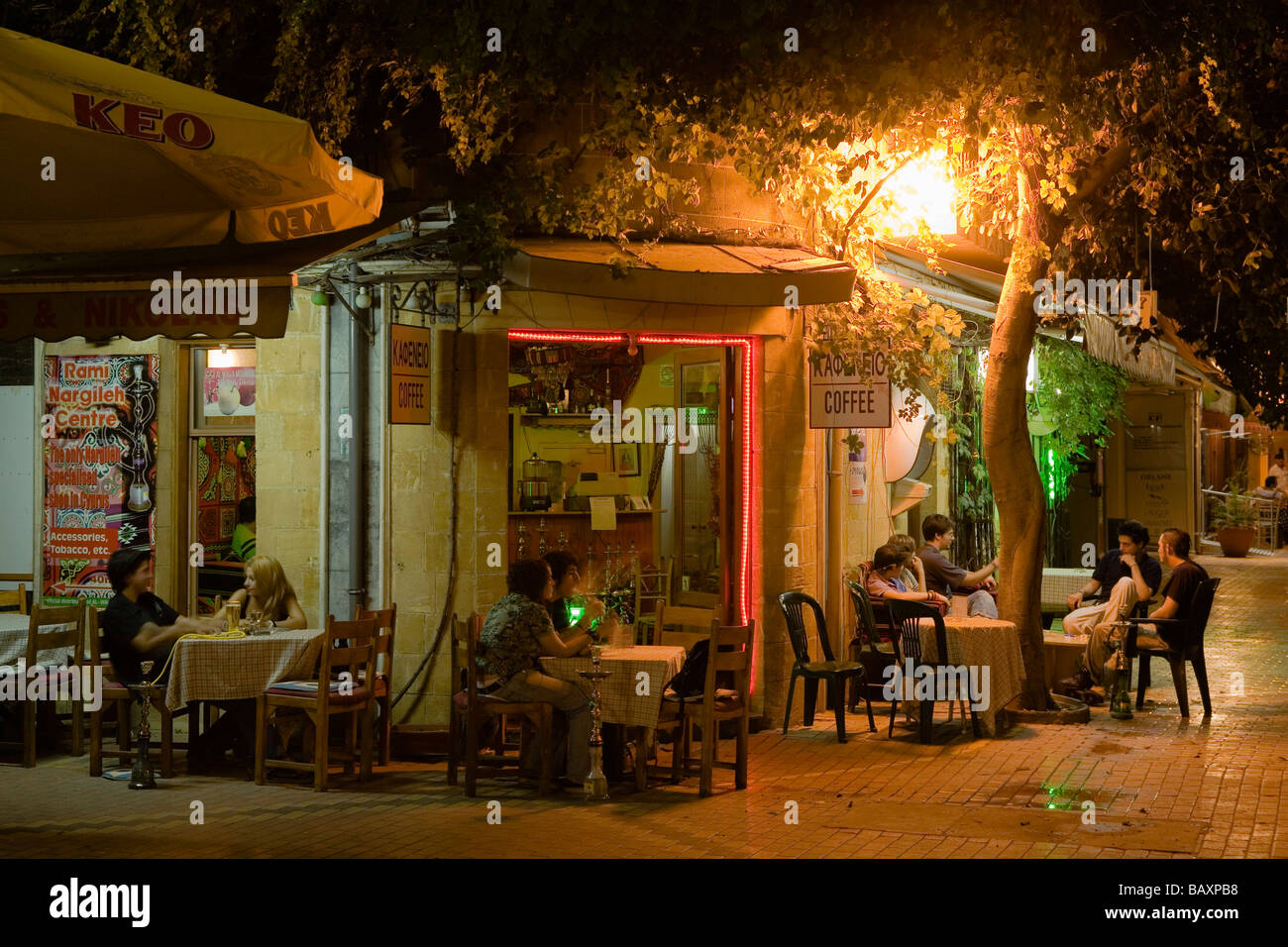People Sitting Outside A Cafe Coffee Shop At Night Laiki