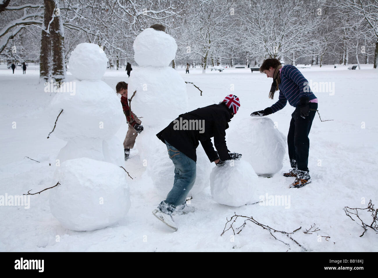 People Making Snowman Family Stock Photo