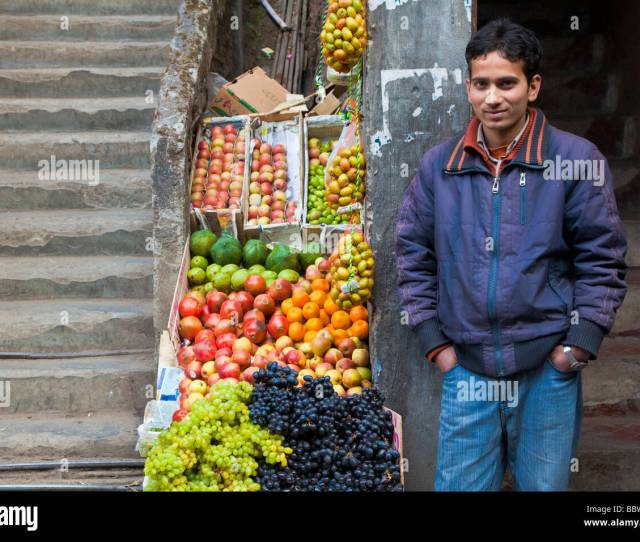 Young Indian Man Selling Fruit At A Market Stall In Darjeeling India Stock Image