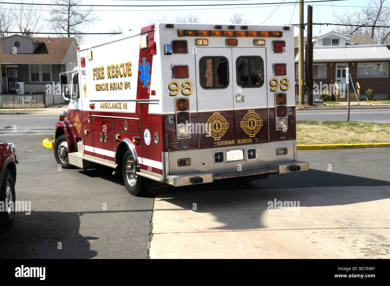 Ambulance Responding To An Emergency 911 Call From Their Firehouse Stock Photo