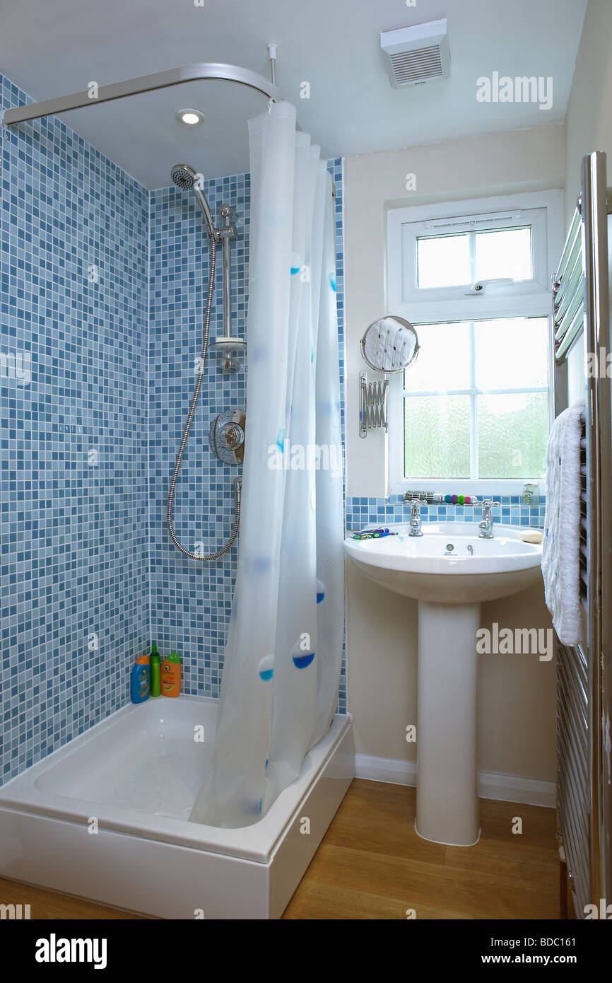 Blue Mosaic Wall Tiles Above Bath With White Shower Curtain In Stock Photo 25465273 Alamy