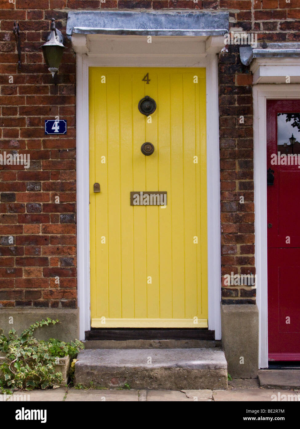 Yellow Front Door In A Row Of Victorian Terraced Houses Cottages Stock Photo Alamy
