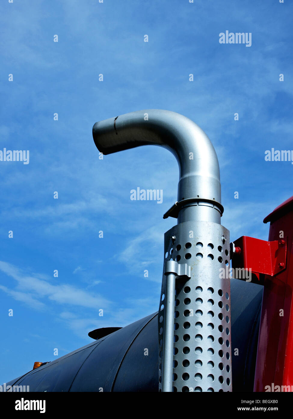 https www alamy com stock photo exhaust pipe on side of large truck sticking up in the air to a blue 26187476 html