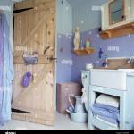 Stripped Pine Door In Cottage Bathroom With Two Tone Painted Blue Stock Photo Alamy