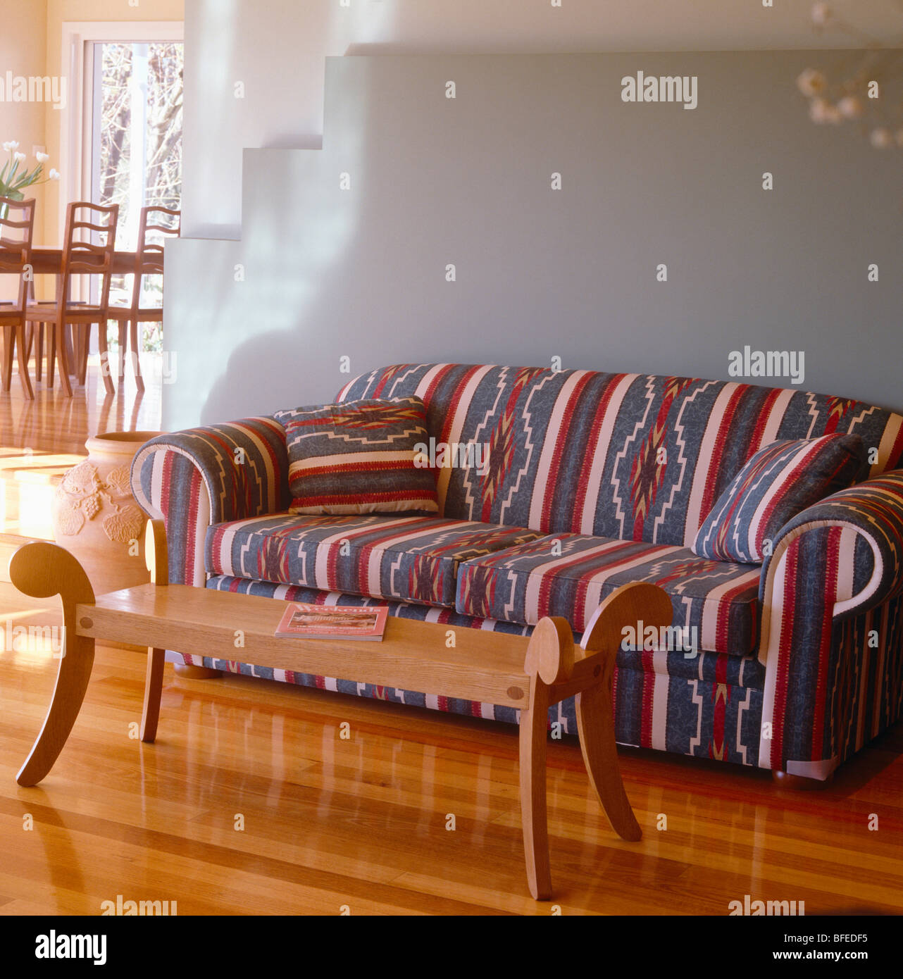 https www alamy com stock photo patterned sofa and wood coffee table in pale grey modern living room 26748153 html