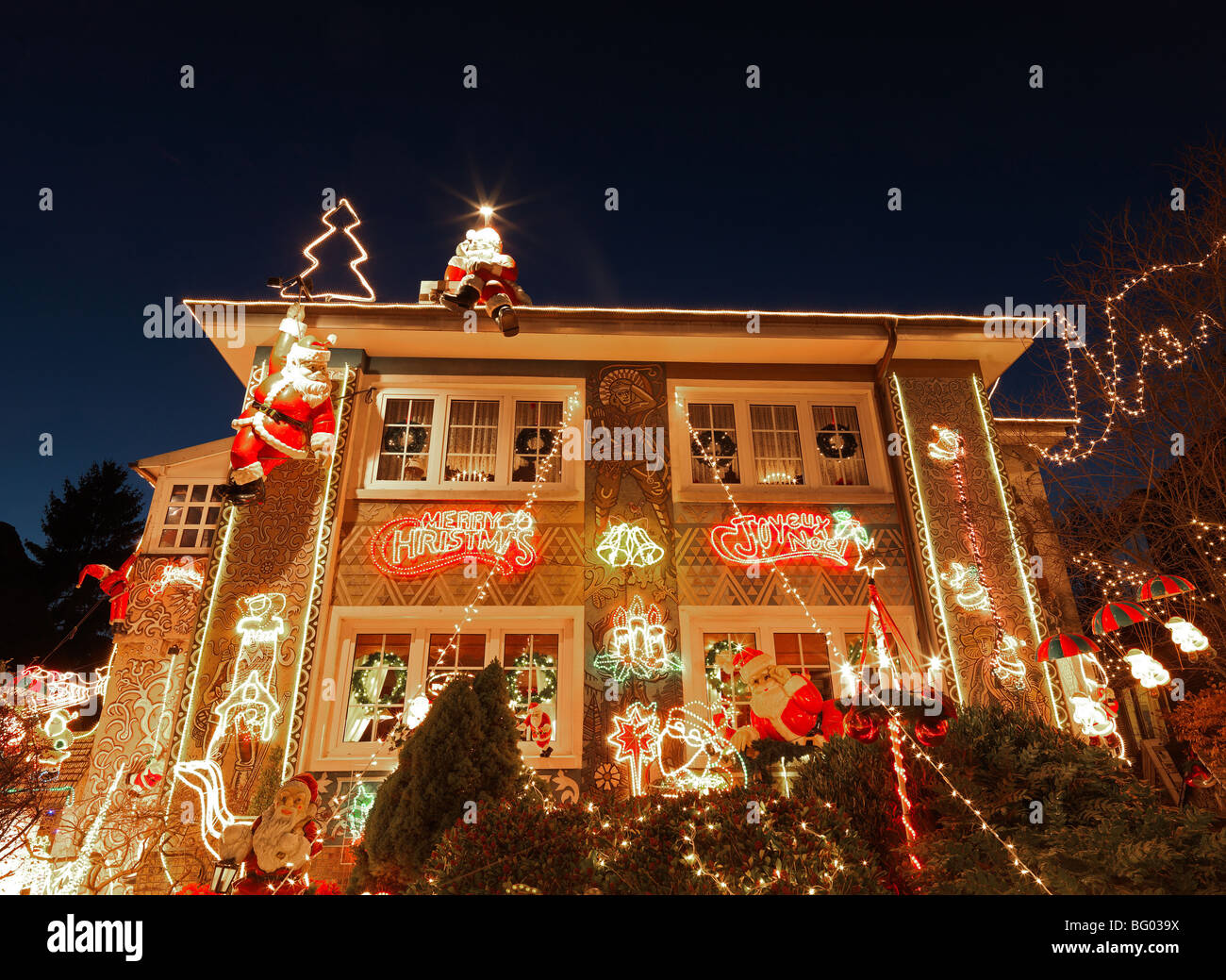 The Colourful Lights Of A Decorated Christmas House With Santa Claus Stock Photo Alamy