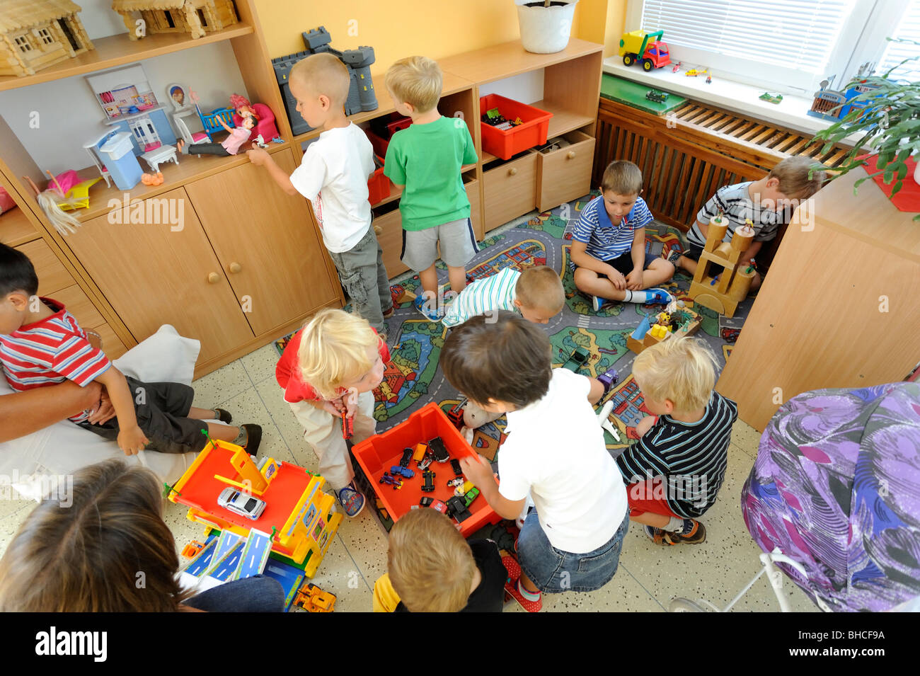 Preschool Children Playing In Class With Toys Stock Photo