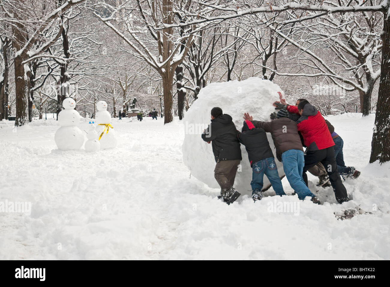 People Building A Snowman In Central Park During Record