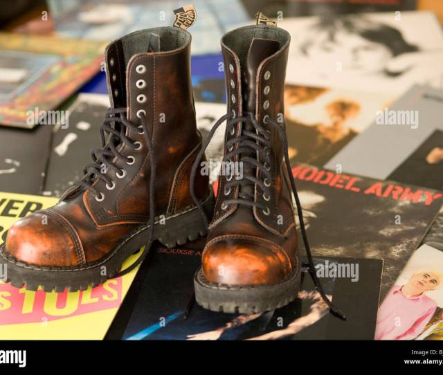 Pair Of Punk Rock Style Orange Brown Boots On Classic Punk Rock Album Covers From The Late 1970s And Early 1980s