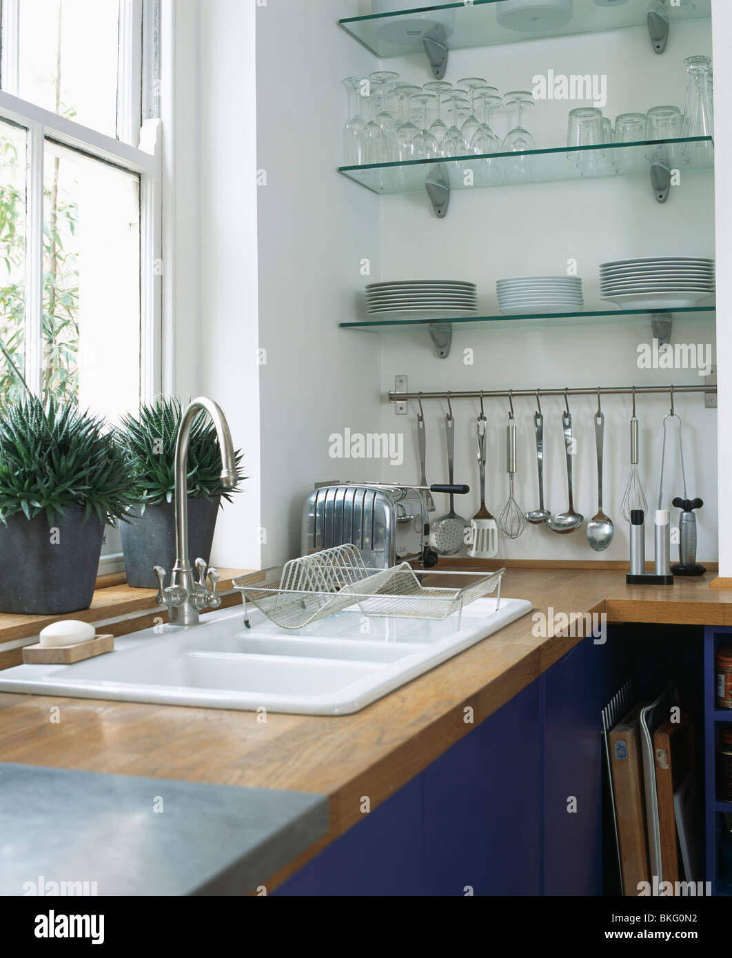 Double White Sink Below Window In Modern Kitchen With