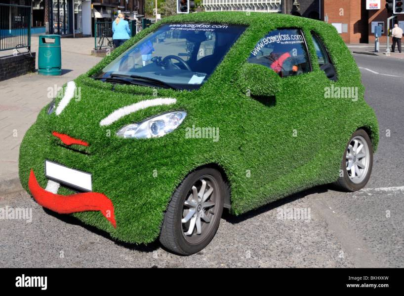 Smart car covered in and advertising artificial grass Stock Photo     Smart car covered in and advertising artificial grass