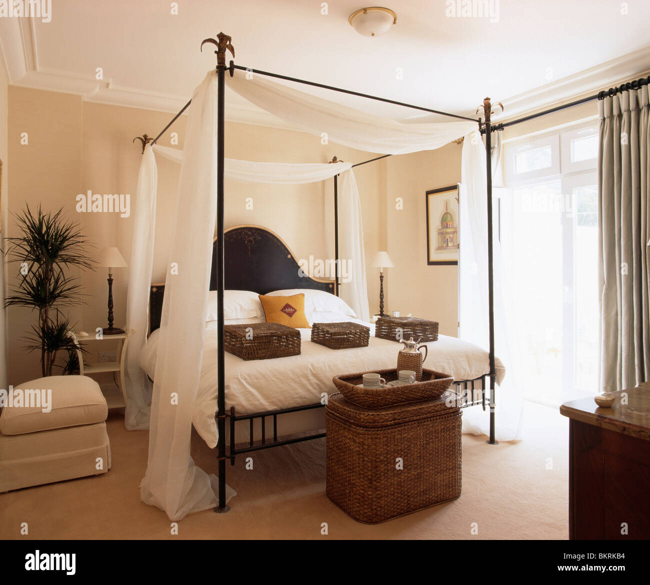 https www alamy com stock photo black metal four poster bed with white and bed linen in modern bedroom 29408936 html