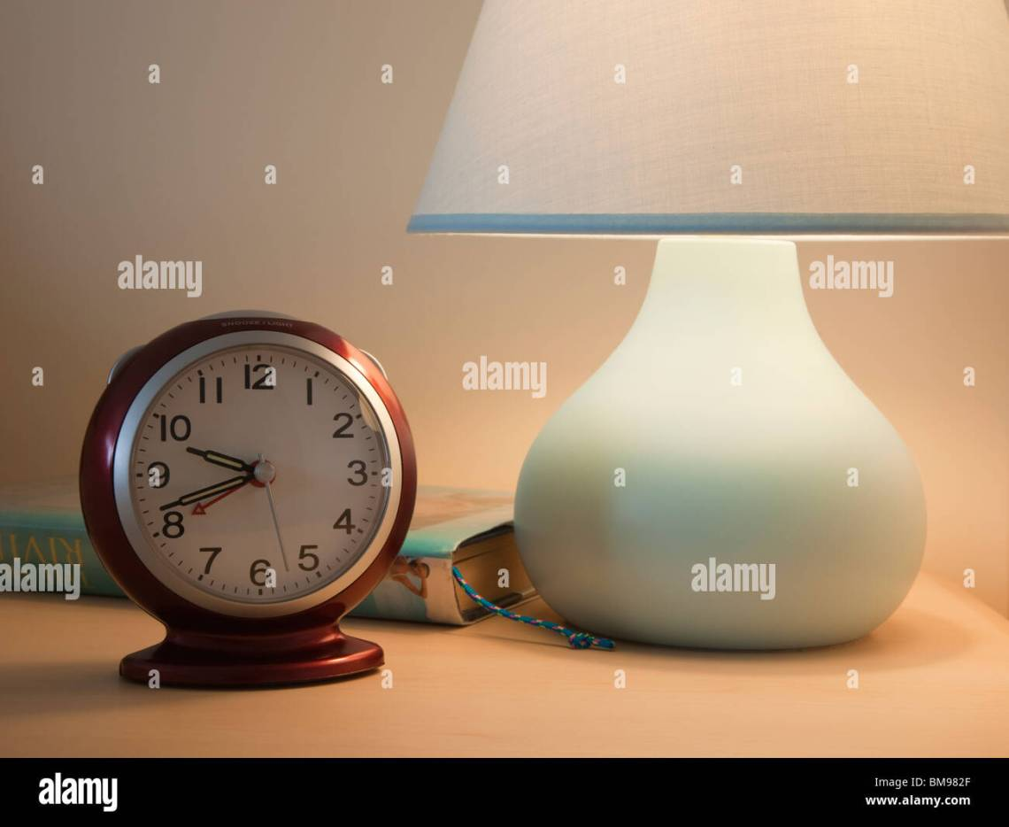 Amazing Alarm Bedside - close-up-of-an-alarm-clock-with-lit-bedside-table-lamp-and-book-at-BM982F  You Should Have_288583.jpg