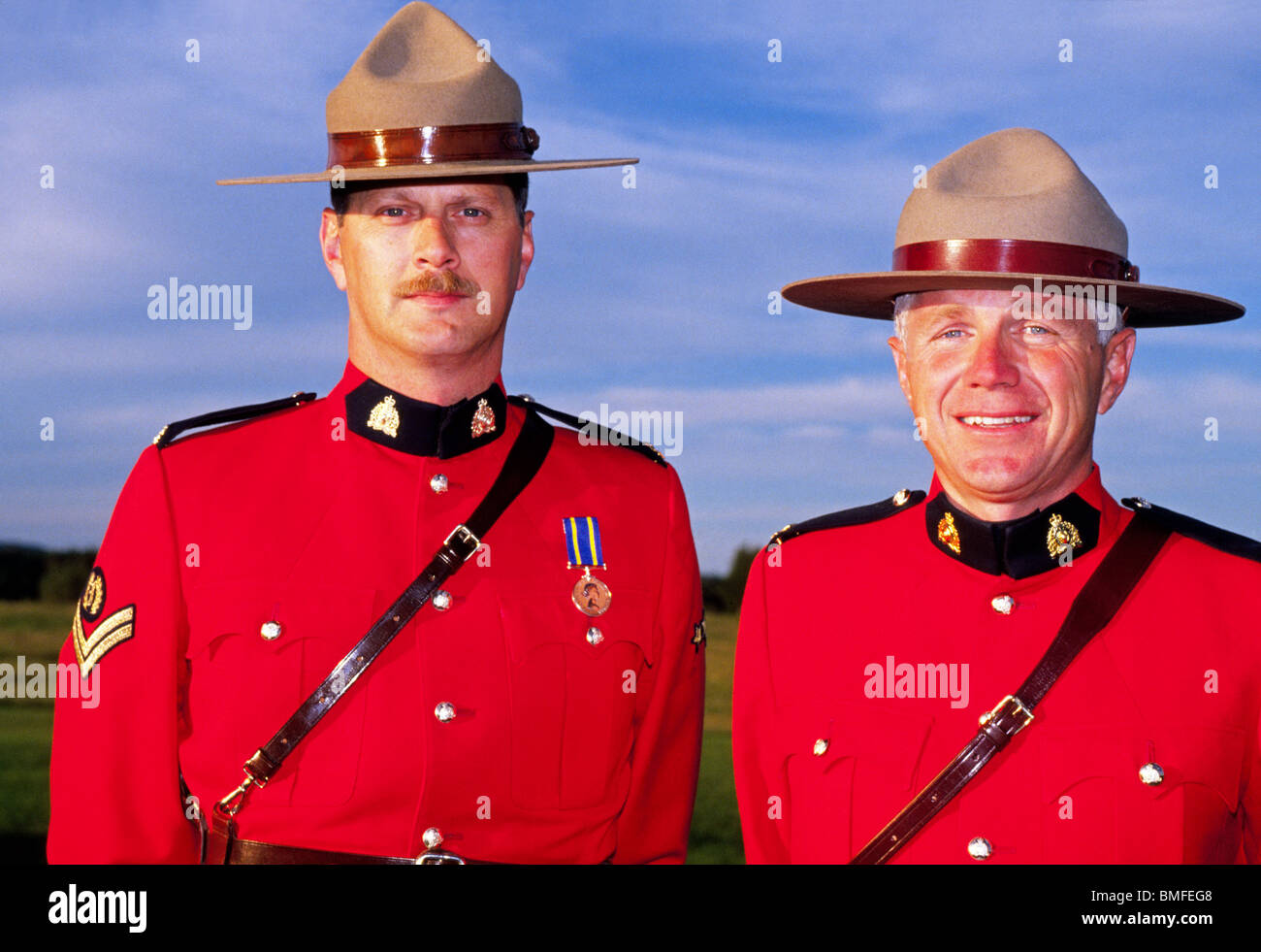 Two Smiling Royal Canadian Mounted Police In Their