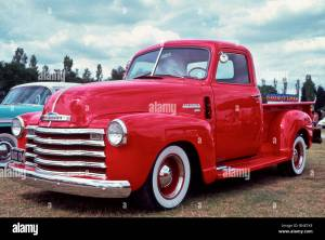1950 Chevrolet stepside pick up truck in bright red Stock