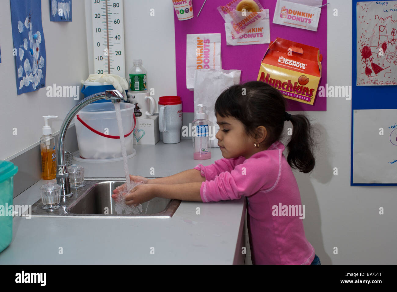 4 Year Old Preschool Girl Washing Her Hands At The Sink In School Stock Photo