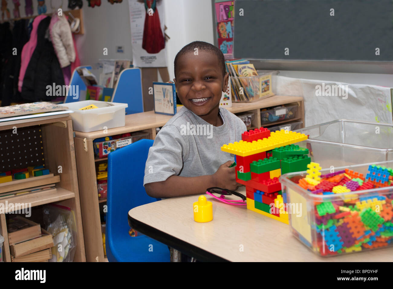 African American Preschool Boy Playing With Lego S In The