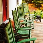 Green Rocking Chairs On Front Porch Of White Rural Farmhouse Stock Photo Alamy
