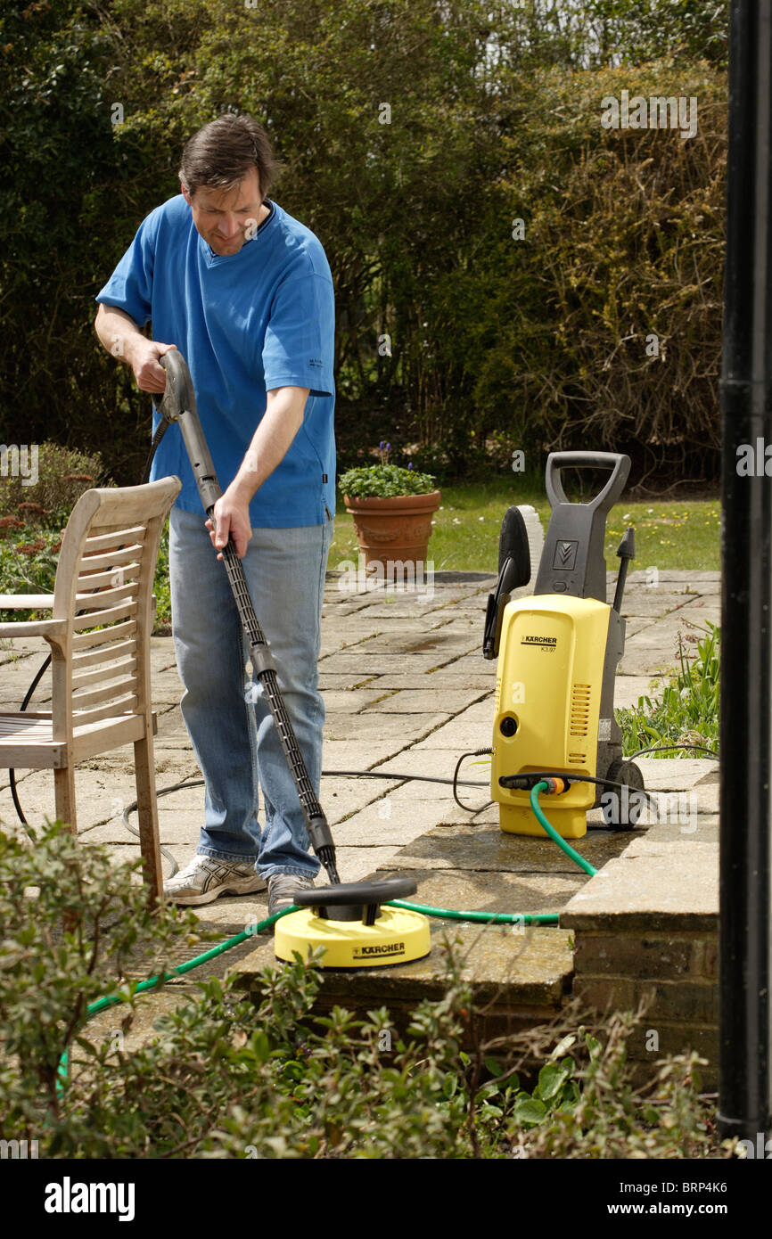 https www alamy com stock photo man using a pressure washer to clean a patio 31834074 html
