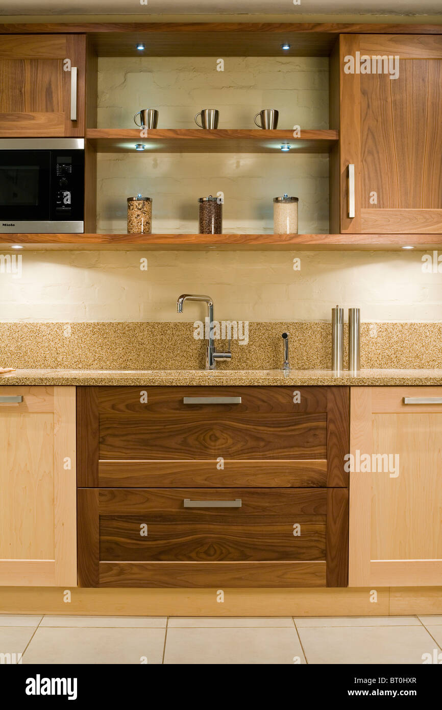 https www alamy com stock photo down lit shelves above sink in fitted unit with dark wood drawers 31976191 html