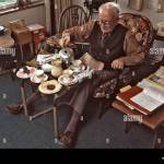 Elderly Man Sitting With A Tv Tray Having A Traditional Afternoon Tea Stock Photo Alamy