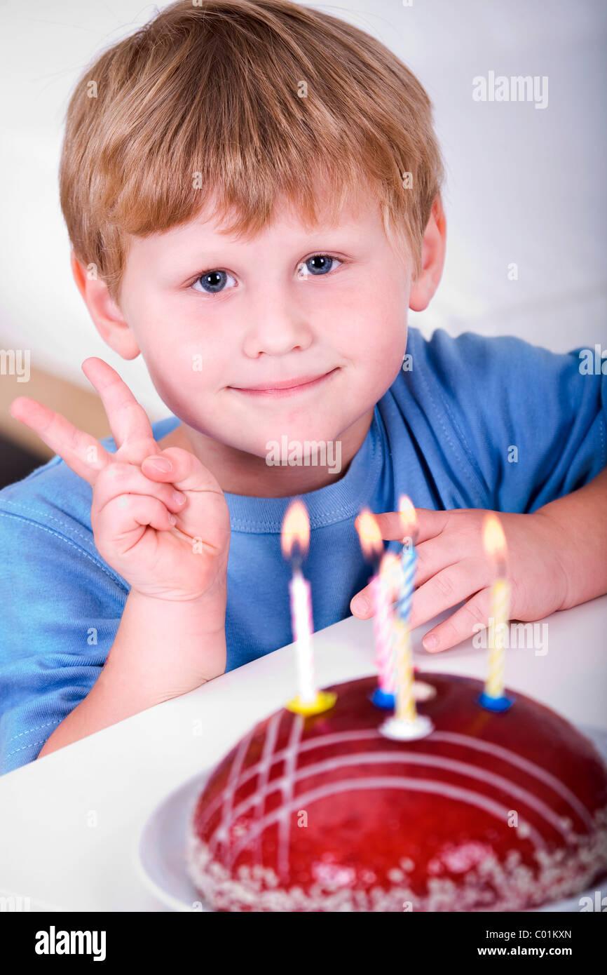 4 Year Old Boy With Birthday Cake Stock Photo Alamy