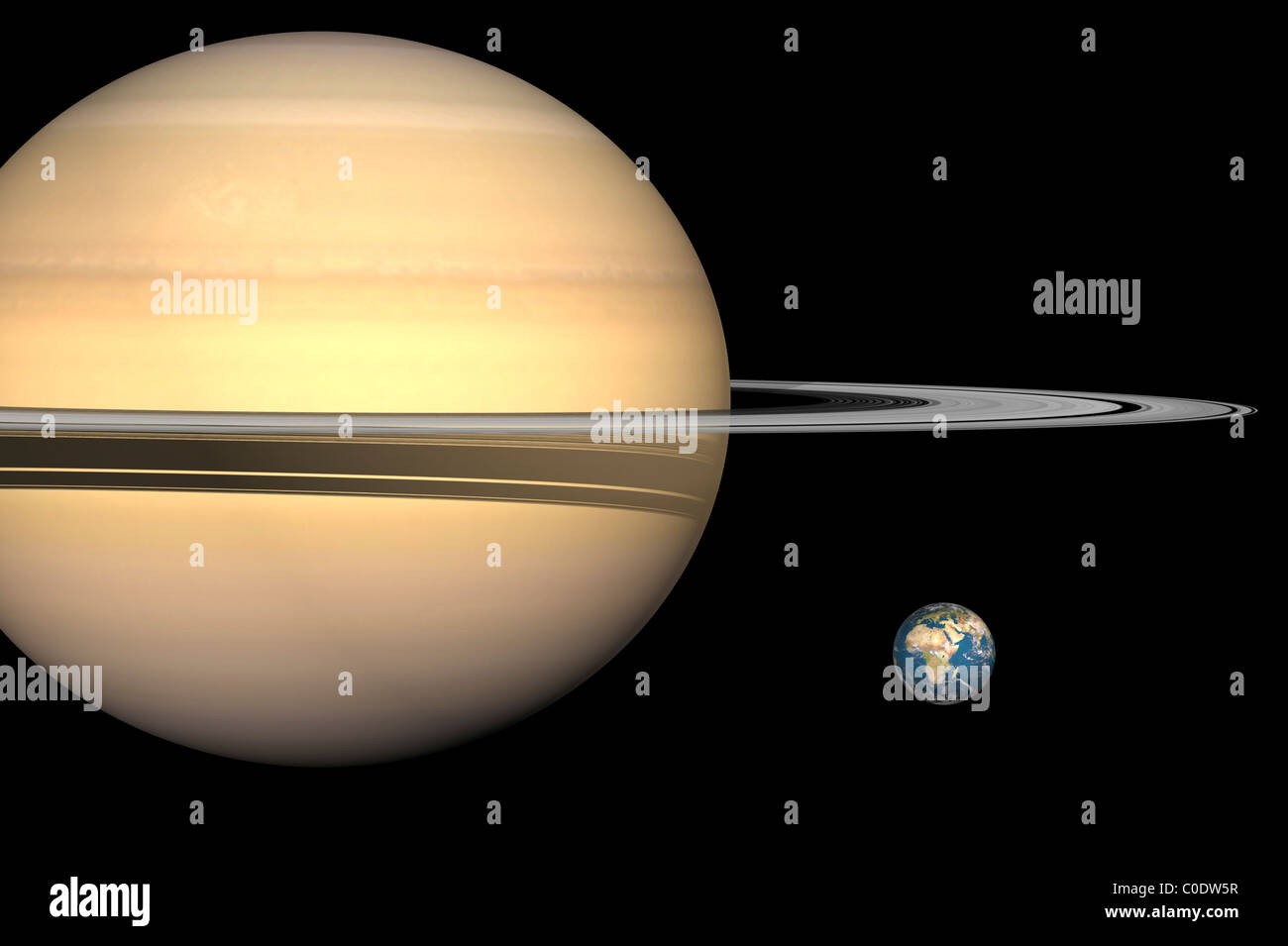 Illustration Of Saturn And Earth To Scale Stock Photo