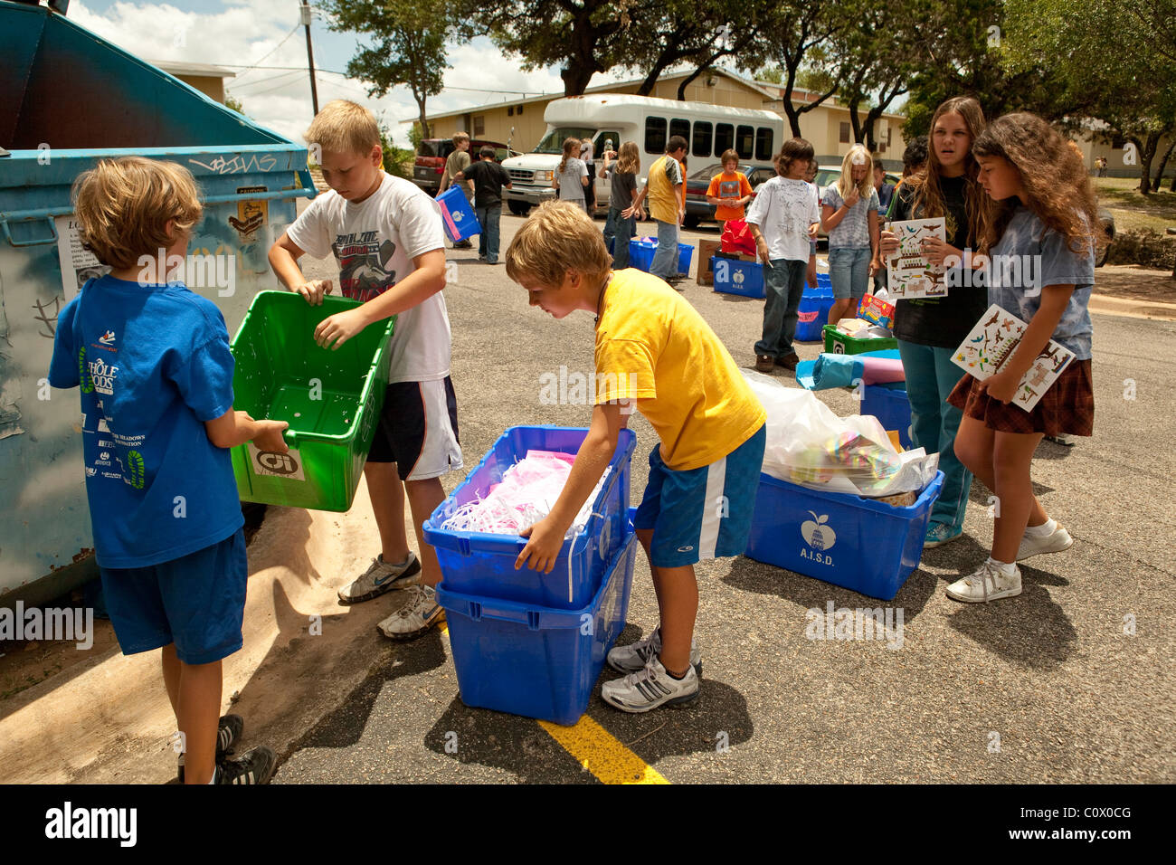 Fifth Grade Elementary Students Carry Papers To Recycle