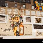 A Advertisement For Sailor Jerry Spiced Rum Painted On A Wall In The Stock Photo Alamy