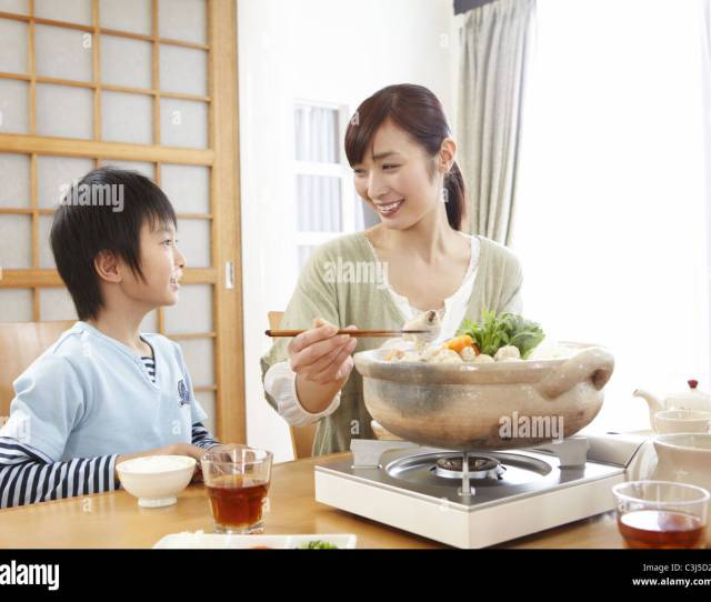 Mother And Son Sitting Around Japanese Hot Pot