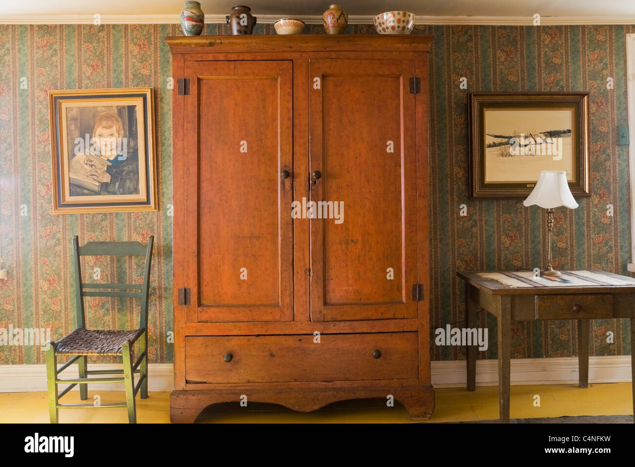 antique armoire in bedroom of 19th century home quebec canada stock image