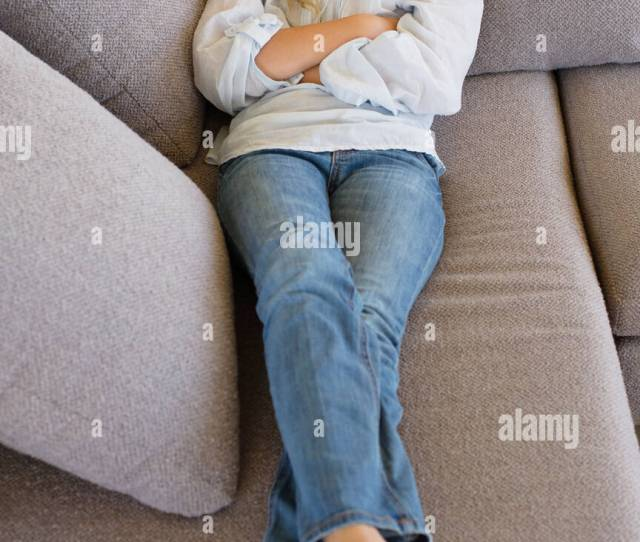 High Angle View Of A Girl Sleeping On A Couch Stock Image